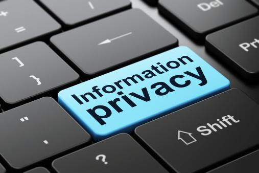 Information Privacy on computer keyboard background